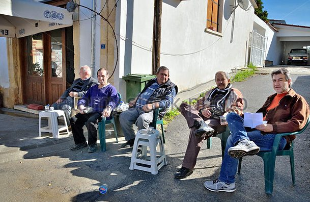 men sitting on the chairs on the street in lefka northern cyprus ekhwx e